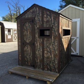 6x6 hunter shack, camo siding w/ brown trim, green dim. shingles